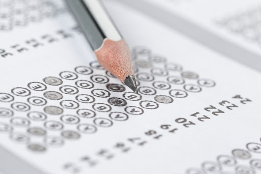 a test answer document with bubbles and a pencil