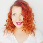 headshot of woman with curly red hair